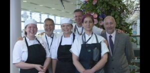 Group photo – First row, left to right: Emma, Holly, Emily, Simon Genduso, Professional Cookery Lecturer at Activate Learning. Second row, left to right: Raymond Blanc OBE, and unknown member of staff.
