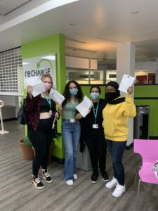 Four Reading students celebrating A Level results